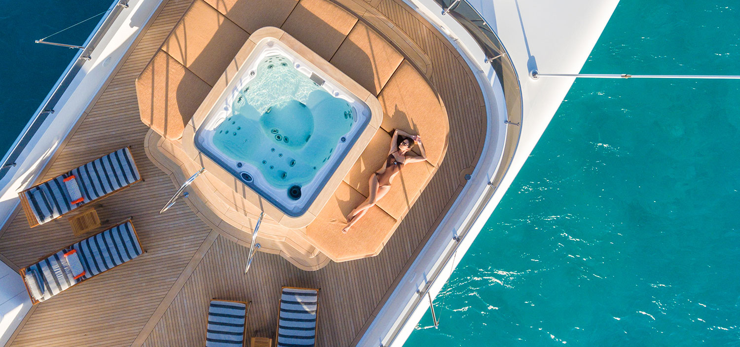 Relax on the sun deck of your yacht charter
