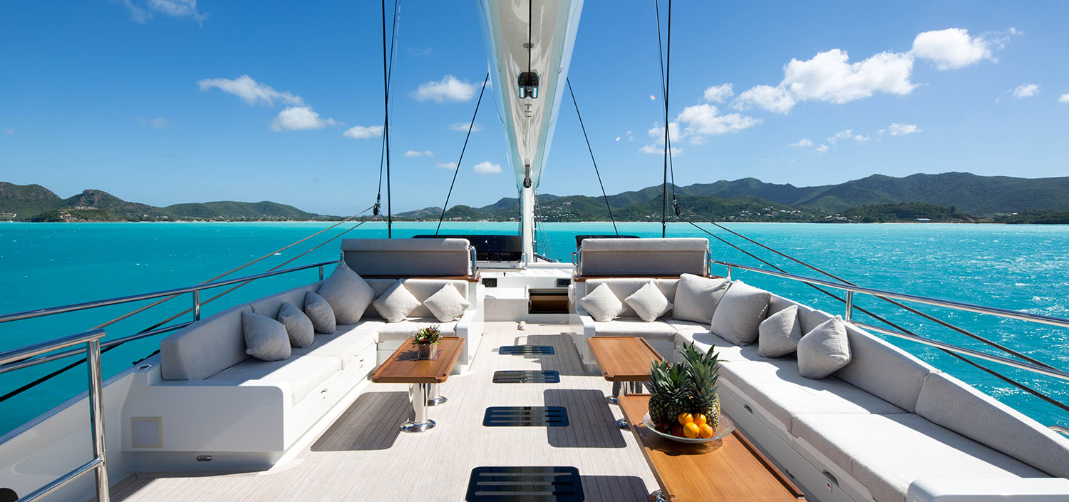 Sail to azure waters on a charter yacht with Fraser