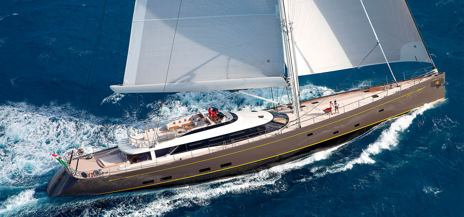 A sailing superyacht carving the waves with Fraser