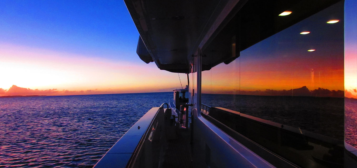 Admire pink shades at sunset on an Australasia yacht charter