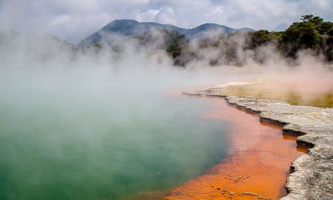 Volcanic water with orange minerals release vaoup over the natural landscape on a Rotorua superyacht charter