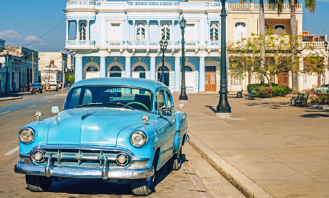 A old fashioned blue car is just one of the iconic sights you'll see on a Cuban yacht charter with Fraser