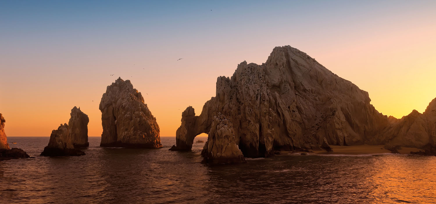 Explore stunning rock formations on a Central America yacht charter at sunset