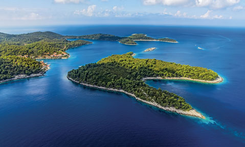 A Croatia yacht charter sails to Adriatic islands covered in lush wildlife set in blue waters