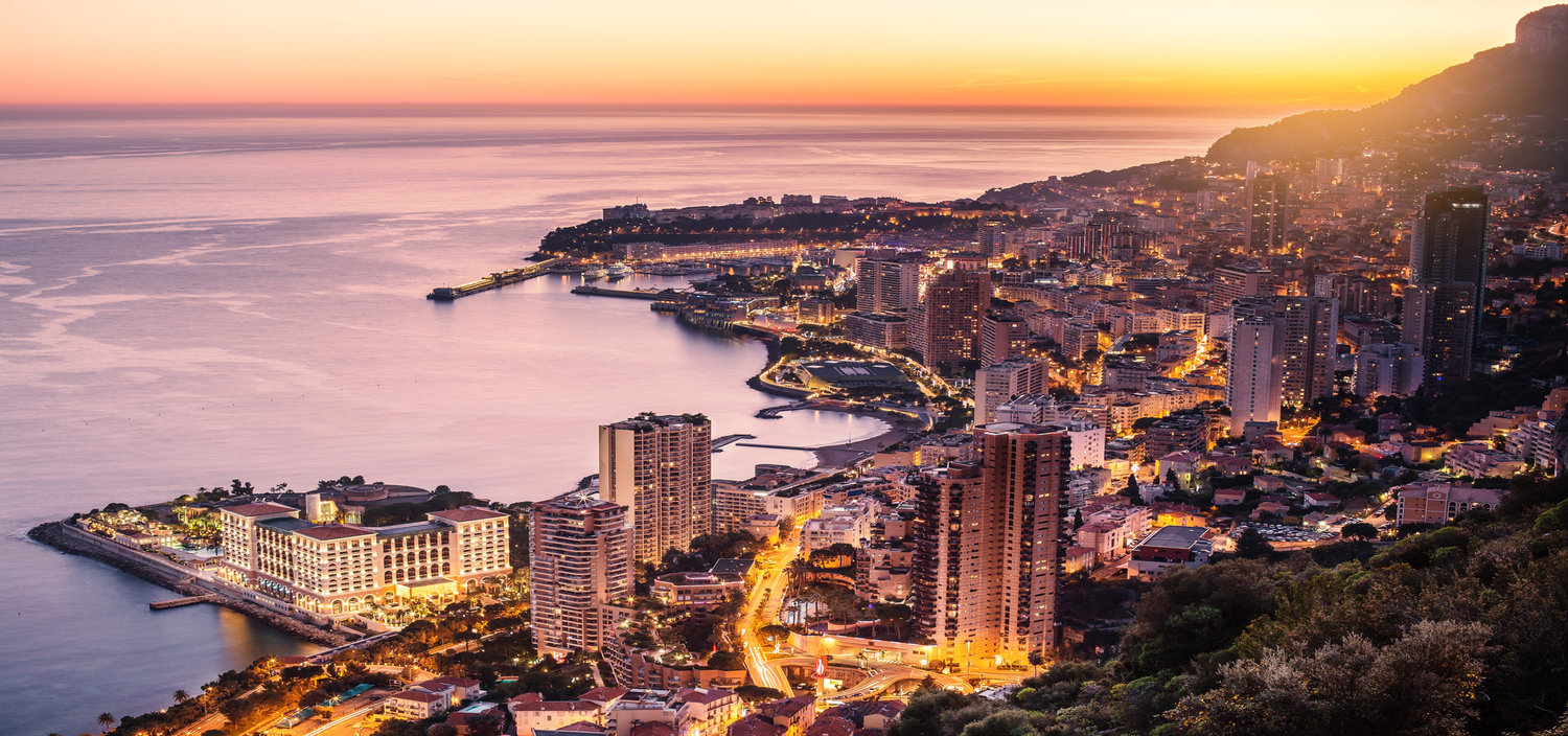 A Monaco yacht charter at night offers amazong views of the Principality