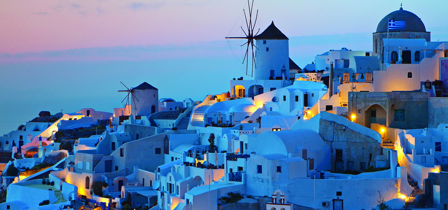 Greece: the Cyclades yacht charter itinerary. The famous white buildings of the Cyclades at nighttime, best appreciates from a luxury yacht charter