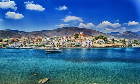 Discover sunny seaside towns perched on azure waters on a Greece yacht charter