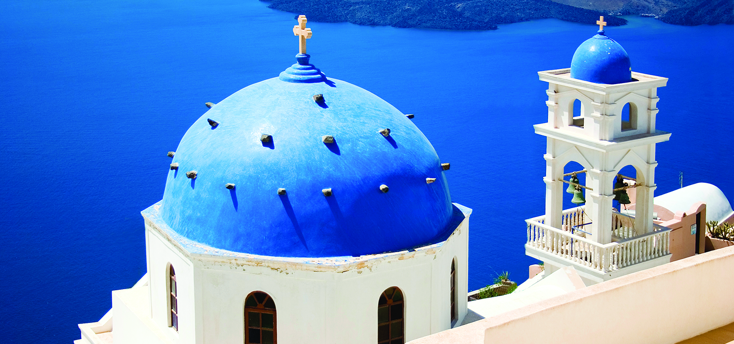 A Greece yacht charter with Fraser takes you past white churches with blue roofs
