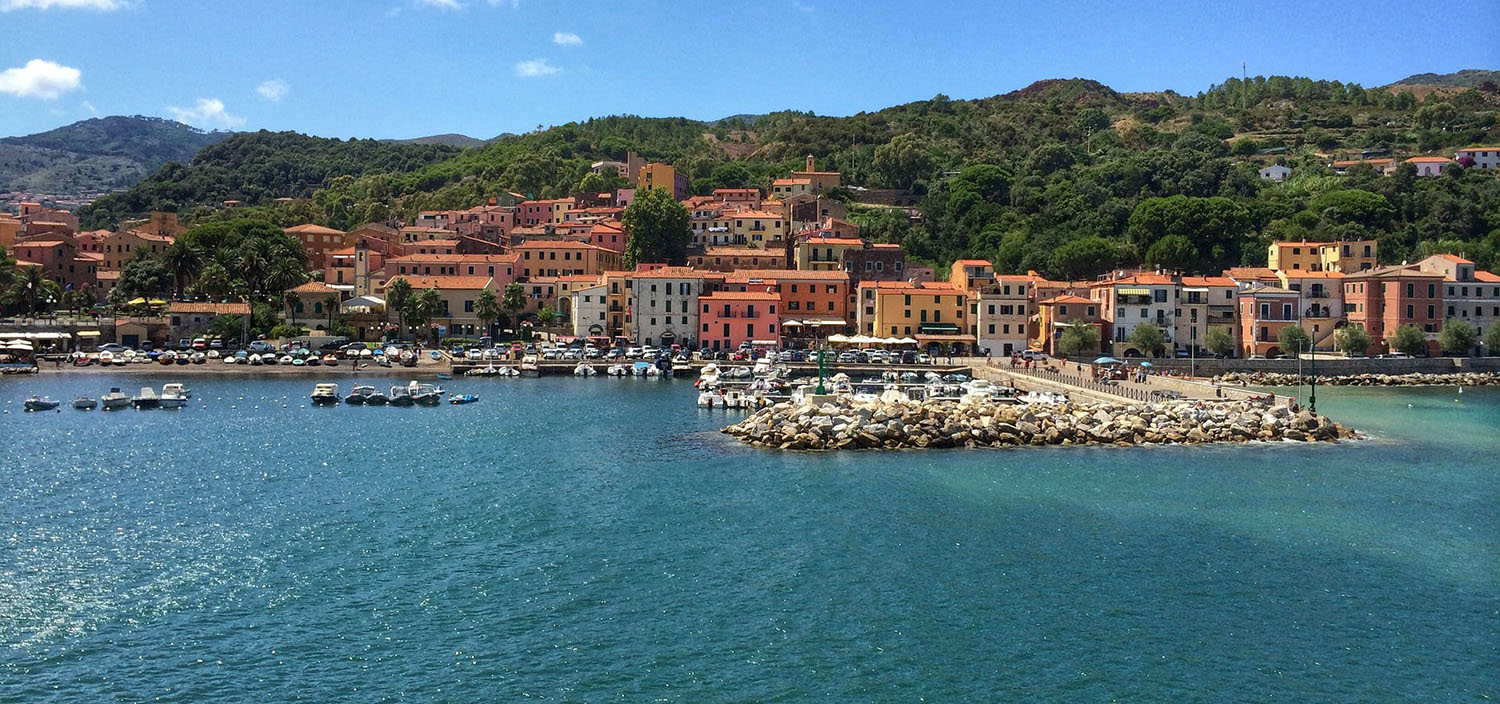 Elba yacht charter seaside town with orange walls