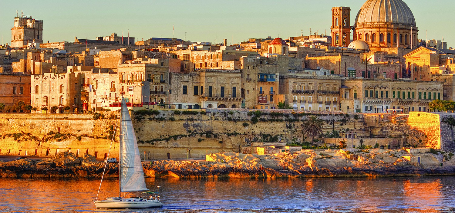 A Malta yacht charter is ideal for cruising next to the city at sundown when golden light covers the island