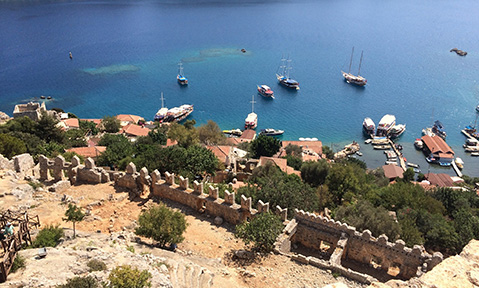Kekova region yacht charter mooring far below the rampards of small town harbour
