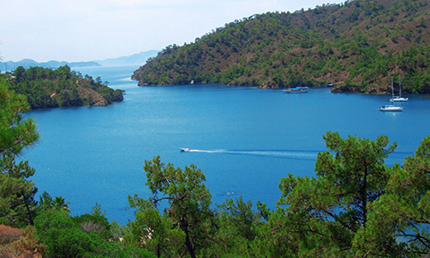 A Marmaris yacht charter is dotted with hidden bays and sweeping mountain views of pine forests