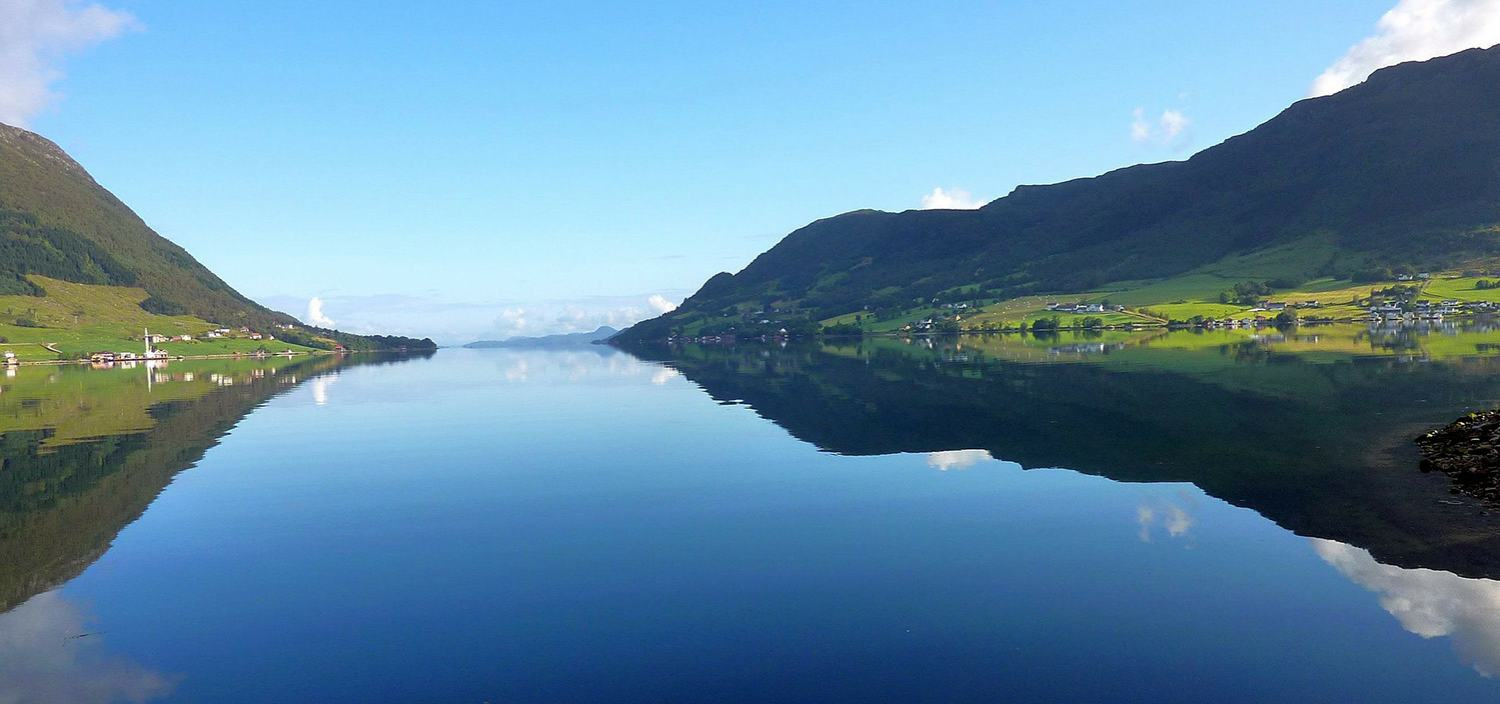 A Northern Europe yacht charter offers stll water and blue skies