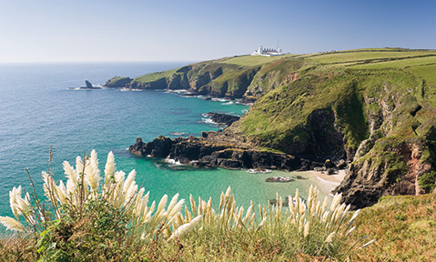 The wild cliffs of the United Kingdom overlook the sea, the perfect destination for a United Kingdom yacht charter