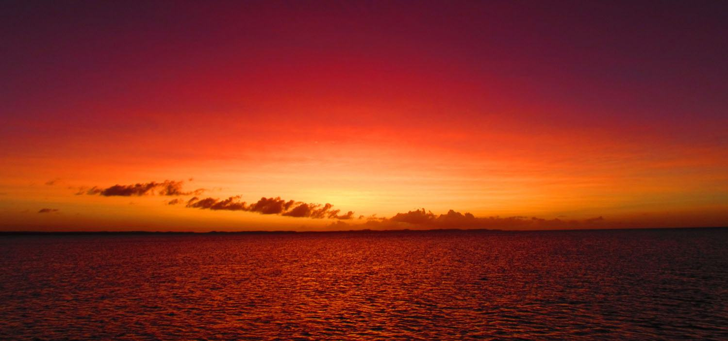 Experience the most vibrant pink and orange sunsets on a South East Asia yacht charter