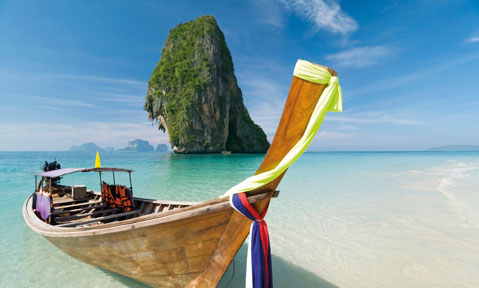 South East Asia yacht charters take you to white sand beaches with beautiful rock formations
